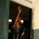 A visually impaired school teacher leaves class in Uganda.