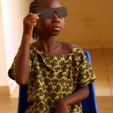 A young girl has her eyes tested in Malawi.