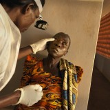 A women has her eyes checked at an eye camp in Uganda.