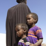 Sahra and her big brother Abdulrisak walk up to 30 km a day to find clean water with their mother.