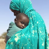 Xawo Ahmed Yousuf, 30, arrives at a water point with her daughter Ayan. They walked several km to find clean water near Burco.