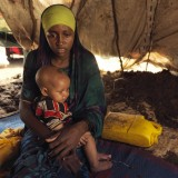 Portrait of Raho, 18, and her malnourished son struggle to find clean water