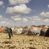 In Baidoa, at least 155,000 have been displaced from their homes because of drought are residing in temporary huts.